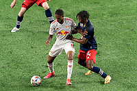 FOXBOROUGH, MA - MAY 22: Kyle Duncan #6 of New York Red Bulls attempts to control the ball as DeJuan Jones #24 of New England Revolution defends during a game between New York Red Bulls and New England Revolution at Gillette Stadium on May 22, 2021 in Foxborough, Massachusetts.