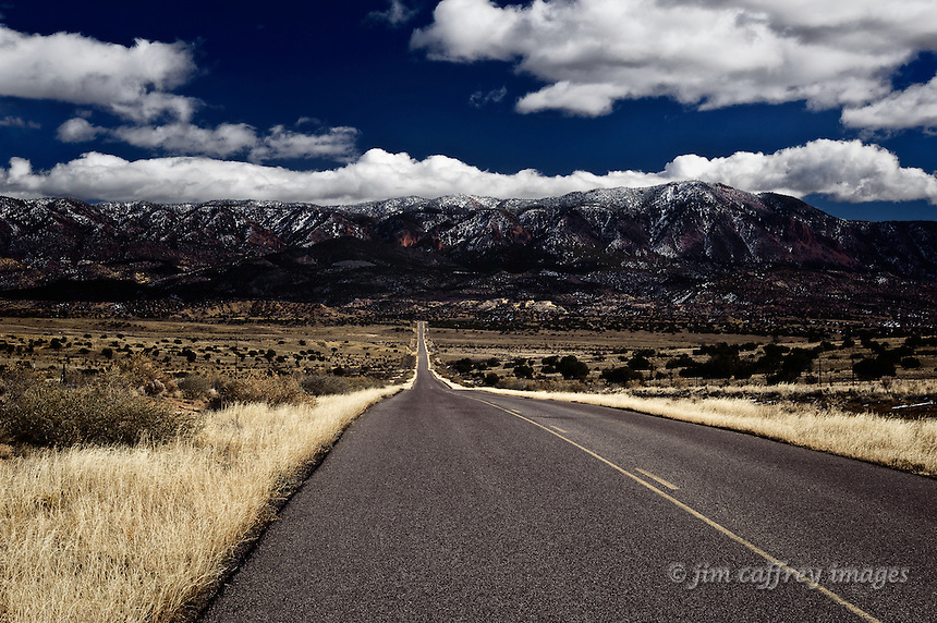 Sandoval County Rd. 279 north of the village of San Luis runs straight for miles toward the Jemez Mountains in the distance