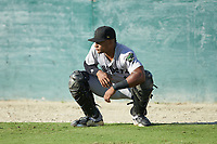 Augusta GreenJackets catcher Andres Angulo (1) warms up in the outfield prior to the game against the Kannapolis Intimidators at Kannapolis Intimidators Stadium on June 21, 2019 in Kannapolis, North Carolina. The Intimidators defeated the GreenJackets 6-1. (Brian Westerholt/Four Seam Images)