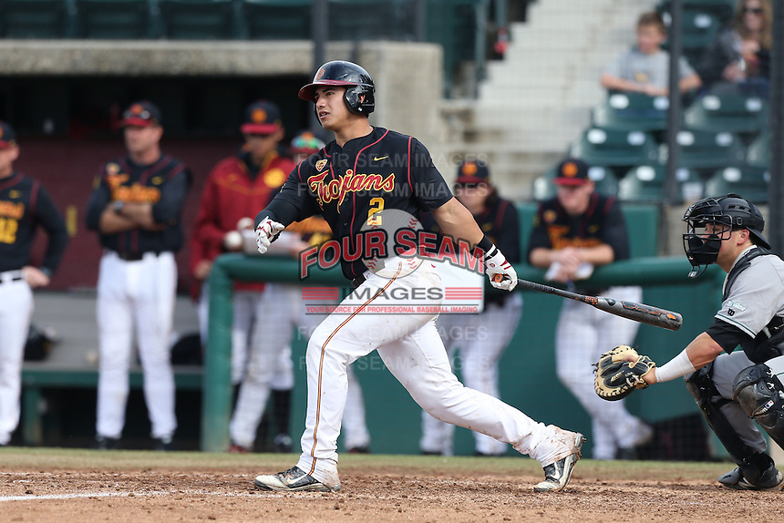 Jeremy Martinez #2 of the USC Trojans bats against the Cal Poly Mustangs at Dedeaux Field on March 2, 2014 in Los Angeles, California. Cal Poly defeated USC, 5-1. (Larry Goren/Four Seam Images)
