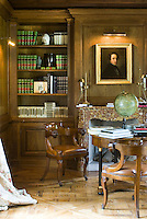The panelled library has a formal masculinity in its decoration