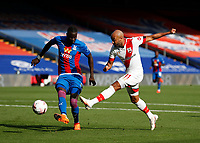 12th September 2020; Selhurst Park, London, England; English Premier League Football, Crystal Palace versus Southampton; Nathan Redmond of Southampton taking a shot passed Cheikhou Kouyate of Crystal Palace