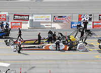 Apr. 7, 2013; Las Vegas, NV, USA: NHRA top fuel dragster driver Clay Millican (near lane) paired alongside Steve Faria in the staging lanes during the Summitracing.com Nationals at the Strip at Las Vegas Motor Speedway. Mandatory Credit: Mark J. Rebilas-
