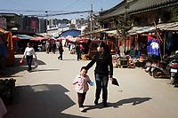 CHINA. Street scene in Zijun village in Kunming, home of the Samatao minority. 2010