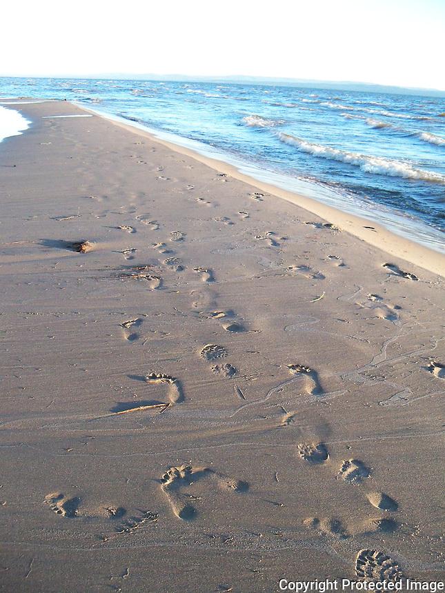 Sand footprints on the beach at Slave Lake.