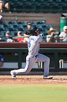 Surprise Saguaros shortstop Santiago Espinal (6), of the Toronto Blue Jays organization, follows through on his swing during an Arizona Fall League game against the Scottsdale Scorpions at Scottsdale Stadium on October 26, 2018 in Scottsdale, Arizona. Surprise defeated Scottsdale 3-1. (Zachary Lucy/Four Seam Images)