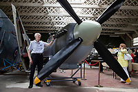 BNPS.co.uk (01202) 558833. <br /> Pic: CorinMesser/BNPS<br /> <br /> Pictured: Norman Parker, who built Spitfires between 1944 and 1946, gets the chance to inspect the model. <br /> <br /> A full-sized model Spitfire has been built as a memorial to the women and children who constructed over 2,000 of them in secret during World War Two.<br /> <br /> The crucial little-known operation involved just a few hundred people who operated in requisitioned car garages, sheds, workshops and factories in the city of Salisbury, Wilts.<br />  <br /> They had to sign of Official Secrets Act and worked with such discretion that the Wiltshire city's inhabitants were oblivious to it.<br /> <br /> They built the legendary aircraft in piecemeal, with the parts coming together to be assembled in one large factory that is now the local rugby club.