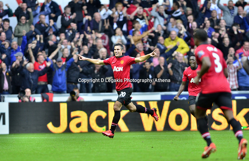 Robin Van Persie celebrating his second goal of the game.<br /> Saturday 17 August 2013<br /> Pictured: <br /> Re: Barclays Premier League Swansea City v Manchester United at the Liberty Stadium, Swansea, Wales