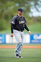 Army West Point head coach Jim Foster (23) walks from the mound after a pitching change during a game against the Michigan Wolverines on February 18, 2018 at First Data Field in St. Lucie, Florida.  Michigan defeated Army 7-3.  (Mike Janes/Four Seam Images)