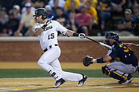 Logan Harvey (15) of the Wake Forest Demon Deacons follows through on his swing against the West Virginia Mountaineers in Game Four of the Winston-Salem Regional in the 2017 College World Series at David F. Couch Ballpark on June 3, 2017 in Winston-Salem, North Carolina.  The Demon Deacons walked-off the Mountaineers 4-3.  (Brian Westerholt/Four Seam Images)