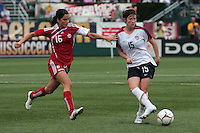 USWNT's Megan Rapinoe(15), rt controls the ball as Canada's Jonelle Filigno (16), left defends. The U.S. Women's National Team defeated 1-0 in a friendly match at Marina Auto Stadium in Rochester, NY on July 19, 2009. Abby Wambach of the USWNT scored her 100th career goal in the second half..