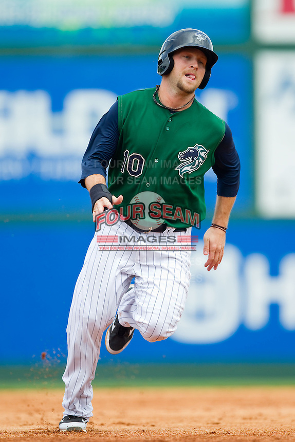 Jim Gallagher (10) of the Charlotte Knights hustles towards third base against the Durham Bulls at Knights Stadium on August 18, 2013 in Fort Mill, South Carolina.  The Bulls defeated the Knights 8-5 in Game One of a double-header.  (Brian Westerholt/Four Seam Images)