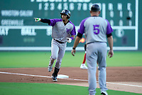 Third baseman Luis Curbelo (16) of the Winston-Salem Dash is greeted by manager Ryan Newman (5) after hitting a home run in a game against the Greenville Drive on Tuesday, June 29, 2021, at Fluor Field at the West End in Greenville, South Carolina. (Tom Priddy/Four Seam Images)