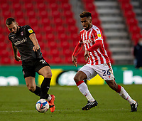 31st October 2020; Bet365 Stadium, Stoke, Staffordshire, England; English Football League Championship Football, Stoke City versus Rotherham United; Joe Mattock of Rotherham United under pressure from Tyrese Campbell of Stoke City