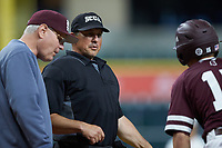 Home plate umpire John Schiller listens as Mississippi State Bulldogs interim head coach Gary Henderson (left) and Jake Mangum (15) plead their case regarding a hit by pitch during the game against the Louisiana Ragin' Cajuns in game three of the 2018 Shriners Hospitals for Children College Classic at Minute Maid Park on March 2, 2018 in Houston, Texas.  The Bulldogs defeated the Ragin' Cajuns 3-1.   (Brian Westerholt/Four Seam Images)