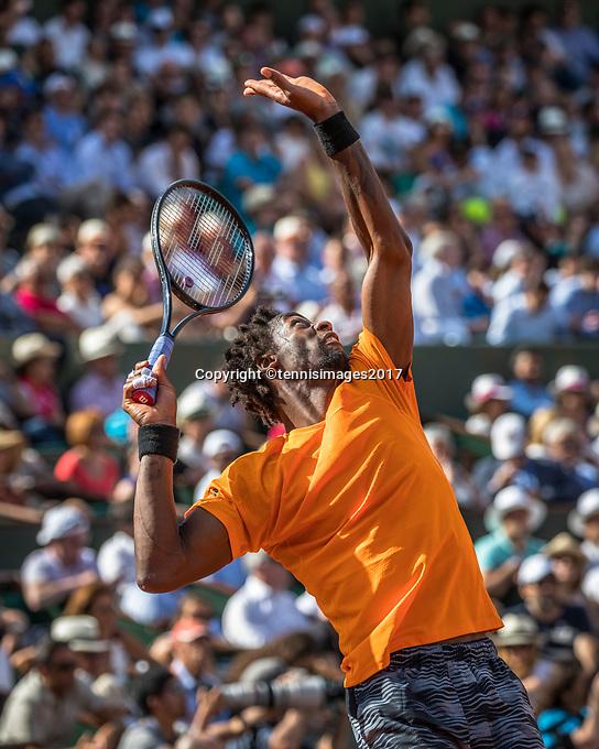 Paris, France, 5 June, 2017, Tennis, French Open, Roland Garros,  Gael Monfils (FRA) serves in his match against Stan Wawrinka.<br /> Photo: Henk Koster/tennisimages.com