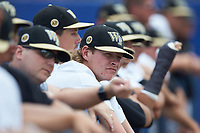 Holden White (21) of the Wake Forest Demon Deacons watches from the dugout during the game against the Florida Gators in the completion of Game Two of the Gainesville Super Regional of the 2017 College World Series at Alfred McKethan Stadium at Perry Field on June 12, 2017 in Gainesville, Florida. The Demon Deacons walked off the Gators 8-6 in 11 innings. (Brian Westerholt/Four Seam Images)