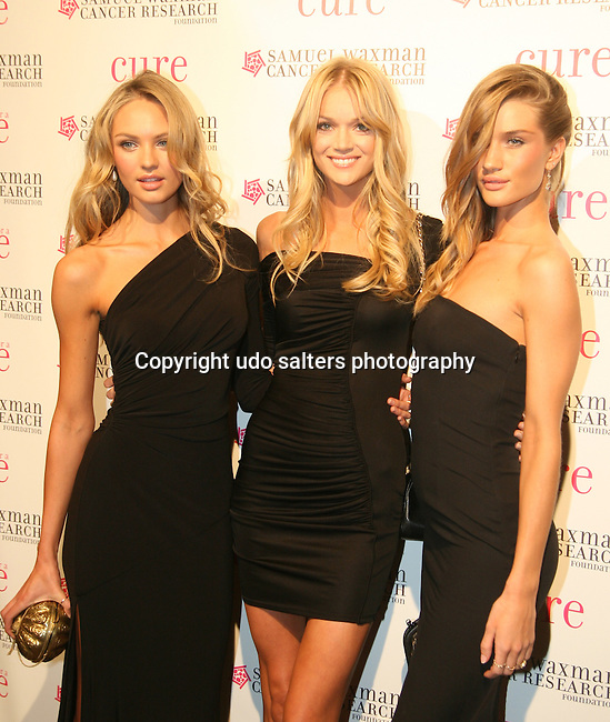Victoria Secret Models Candice Swanepoel, Lindsay Ellingson and Rosie Huntington-Whiteley attend the 12th Annual Collaborating For a Cure Dinner & Auction to benefit the Samuel Waxman Cancer Research Foundation at the Park Avenue Armory, November 18, 2009 .