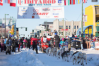 Gunnar Johnson and team leave the ceremonial start line with an Iditarider and handler at 4th Avenue and D street in downtown Anchorage, Alaska on Saturday March 4th during the 2017 Iditarod race. Photo © 2017 by Brendan Smith/SchultzPhoto.com.