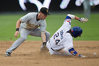 Salt Lake Bees shortstop Andrew Romine (7) misses the ball thrown by the catcher during a steal attempt by Round Rock Express baserunner Jim Adduci (24) in the Pacific Coast League baseball game on August 10, 2013 at the Dell Diamond in Round Rock, Texas. Round Rock defeated Salt Lake 9-6. (Andrew Woolley/Four Seam Images)