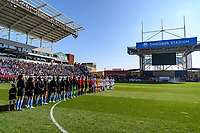 BRIDGEVIEW, IL - OCTOBER 20: The Chicago Red Stars Starting XI, Portland Thorns FC Starting XI, and player escorts stand on the field during a game between Portland Thorns FC and Chicago Red Stars at SeatGeek Stadium on October 20, 2019 in Bridgeview, Illinois.