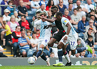 Bolton Wanderers' Sammy Ameobi competing with Blackburn Rovers' Joe Rothwell and Amari'i Bell <br /> <br /> Photographer Andrew Kearns/CameraSport<br /> <br /> The EFL Sky Bet Championship - Blackburn Rovers v Bolton Wanderers - Monday 22nd April 2019 - Ewood Park - Blackburn<br /> <br /> World Copyright © 2019 CameraSport. All rights reserved. 43 Linden Ave. Countesthorpe. Leicester. England. LE8 5PG - Tel: +44 (0) 116 277 4147 - admin@camerasport.com - www.camerasport.com