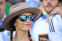 An Argentina fan with the Maracana reflected in her glasses
