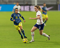 ORLANDO, FL - JANUARY 22: Sam Mewis #3 dribbles away from Orianica Velasquez #15 during a game between Colombia and USWNT at Exploria stadium on January 22, 2021 in Orlando, Florida.