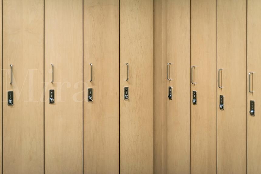 Combination lockers in a heath club locker room.