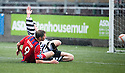 Dennis Wyness slides in to score Elgin's fourth.