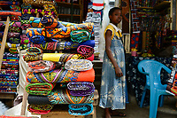 TOGO, Lome, Grande Marche, Grand market, sale of imported chinese wax print fabric for traditional afrian dress/ Grosser Markt, Marktfrauen verkaufen bedruckte Stoffe, made in china