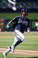 Atlanta Braves Cristian Pache (14) runs to first base after hitting a triple during a Major League Spring Training game against the Boston Red Sox on March 7, 2021 at CoolToday Park in North Port, Florida.  (Mike Janes/Four Seam Images)