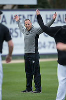 Kannapolis Intimidators conditioning coach Bret Kelly leads the pitchers through some stretches prior to a preseason workout at Kannapolis Intimidators Stadium on April 6, 2016 in Kannapolis, North Carolina.  (Brian Westerholt/Four Seam Images)