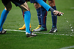 Referee Wolfgang Stark marks with the spray during Champions League soccer match between Atletico de Madrid and Olympiacos at Vicente Calderon stadium in Madrid, Spain. November 26, 2014. (ALTERPHOTOS/Victor Blanco)
