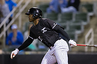 Micker Adolfo (27) of the Kannapolis Intimidators follows through on his walk-off single in the bottom of the ninth inning against the Asheville Tourists at Kannapolis Intimidators Stadium on May 6, 2017 in Kannapolis, North Carolina.  The Intimidators walked-off the Tourists 7-6.  (Brian Westerholt/Four Seam Images)