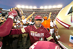 Florida State head coach Willie Taggart tries to separate his team from the Miami team at midfield after Miami defeated Florida State 27-10 in an NCAA college football game in Tallahassee, Fla., Saturday, Nov. 2, 2019. Miami defeated Florida State 27-10.  (AP Photo/Mark Wallheiser)