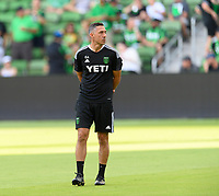 AUSTIN, TX - JUNE 19: Austin FC Assistant Coach, Davy Arnaud watches the team warm up before a game between San Jose Earthquakes and Austin FC at Q2 Stadium on June 19, 2021 in Austin, Texas.