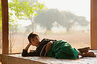 Resting farmers boy outskirts of  Bagan Myanmar/Burma