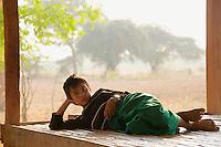 Resting farmers boy outskirts of  Bagan Myanmar/Burma