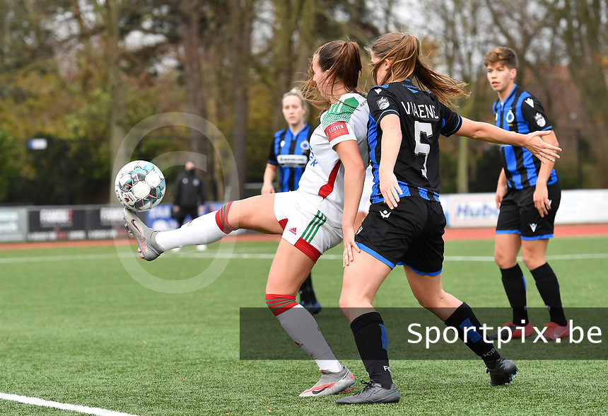 OHL's Hannah Eurlings pictured controlling the ball in front of Raquel Viaene (5 Brugge) during a female soccer game between Club Brugge Dames YLA and Oud Heverlee Leuven on the 8 th matchday of the 2020 - 2021 season of Belgian Scooore Womens Super League , saturday 21 th November 2020  in Knokke , Belgium . PHOTO SPORTPIX.BE | SPP | DAVID CATRY