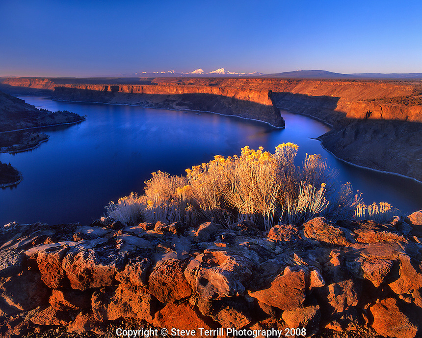 Lake Billy Chinook at sunrise with the Three Sisters on horizon in central Oregon