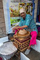 Essaouira, Morocco.  Woman Grinding Argan Nuts to Make Oil.