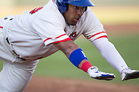 Wearing an Austin Senators throwback uniform, Round Rock Express designated hitter Manny Ramirez (39) slides head first into third base during the Pacific Coast League baseball game against the Oklahoma City RedHawks on July 9, 2013 at the Dell Diamond in Round Rock, Texas. Round Rock defeated Oklahoma City 11-8. (Andrew Woolley/Four Seam Images)