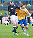 Dundee's Craig Beattie holds off Cowdenbeath's John Armstrong.