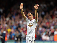 Pictured: Leon Britton of Swansea thanks away supporters at the end of the game<br /> Re: Premier League match between Crystal Palace and Swansea City at Selhurst Park on Sunday 24 May 2015 in London, England, UK