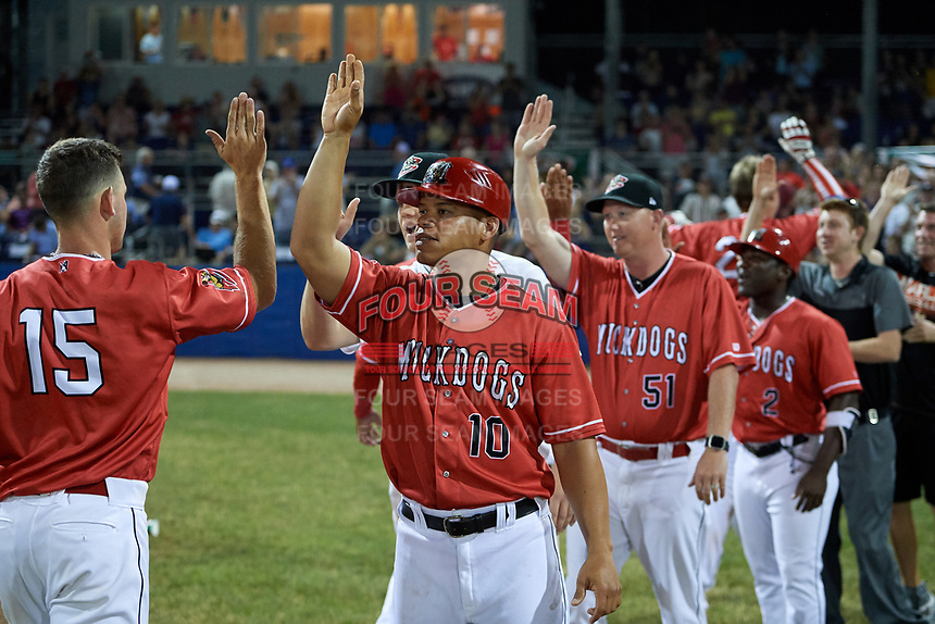 Batavia Muckdogs hitting coach Jesus Merchan (10) and pitching coach Jason Erickson (51) celebrate a walk off win after a game against the West Virginia Black Bears on July 3, 2018 at Dwyer Stadium in Batavia, New York.  Batavia defeated West Virginia 5-4.  (Mike Janes/Four Seam Images)