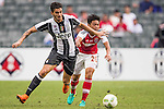 Juventus' player Giulio Parodi battles South China's player Lau Cheuk Hin for the ball during the South China vs Juventus match of the AET International Challenge Cup on 30 July 2016 at Hong Kong Stadium, in Hong Kong, China.  Photo by Marcio Machado / Power Sport Images