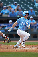 Michael Busch (15) of the North Carolina Tar Heels follows through on his swing against the Florida State Seminoles in the 2017 ACC Baseball Championship Game at Louisville Slugger Field on May 28, 2017 in Louisville, Kentucky. The Seminoles defeated the Tar Heels 7-3. (Brian Westerholt/Four Seam Images)