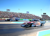 Sept. 22, 2013; Ennis, TX, USA: NHRA funny car driver Cruz Pedregon (right) races alongside Jack Beckman during the Fall Nationals at the Texas Motorplex. Mandatory Credit: Mark J. Rebilas-