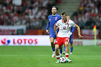 8th September 2021; PGE National Stadium, Warsaw, Poland: FIFA World Cup 2022 Football qualification, Poland versus England;  JACK GREALISH beaten by the run from PAWEL DAWIDOWICZ